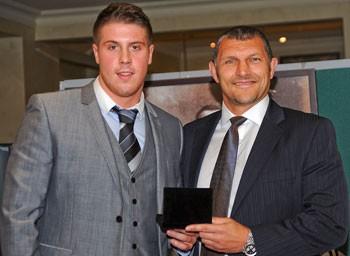 Tom Lineham receives the Rookie award from Barrie McDermott