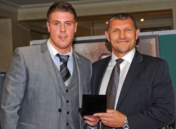 Tom Lineham receives the Rookie award from Barrie McDermott