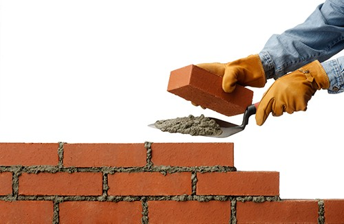 Burgess was brought onto the building site at an early age to lay bricks.