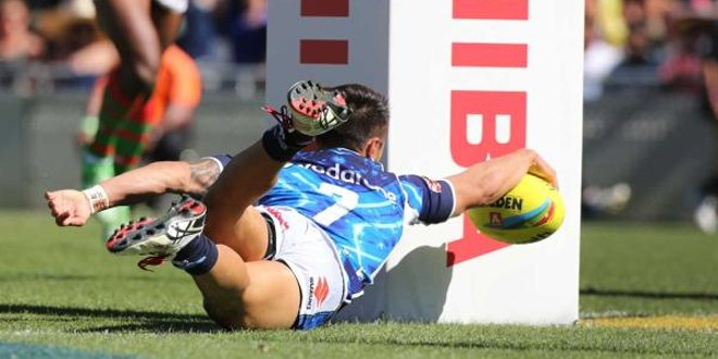 Shaun Johnson stretches over to score for New Zealand Warriors in the Auckland Nines. ©FairfaxMedia