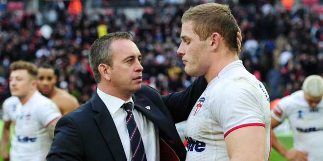 McNamara consoles George Burgess in the World Cup semi-final. ©RLPhotos