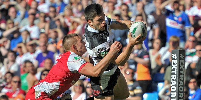 Tom Briscoe (Hull FC) trying to score past Greg Eden of Hull KR. ©RLPhotos