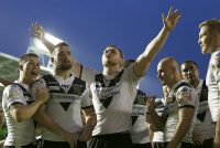 Hull go top after surviving Wigan scare